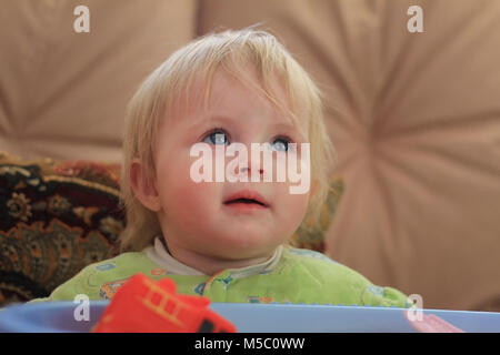 Portrait of a little blue-eyed blonde girl - Stock Photo