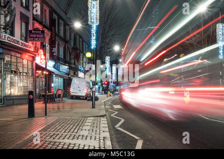 London, England, UK - January 8, 2018: A red double-decker London bus moves along Chalk Farm Road in Camden Town, - Stock Photo