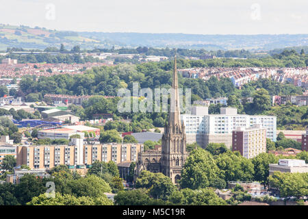 Bristol, England, UK - July 17, 2016: The tall spire of St Mary Redcliffe church and council housing blocks of the - Stock Photo