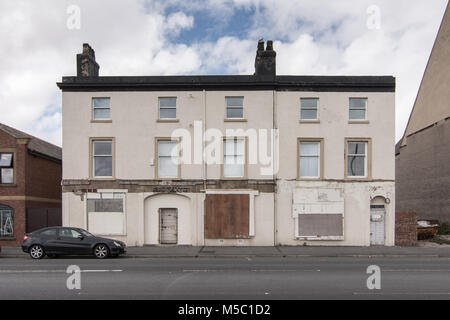 Blackpool, England, UK - August 1, 2015: Houses are boarded up and derelict in Fleetwood, near Blackpool in Lancashire. - Stock Photo