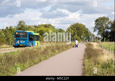 Cambridge, England, UK - August 19, 2017: A pedestrian uses the foot and cycle path alongside the Cambridgeshire - Stock Photo