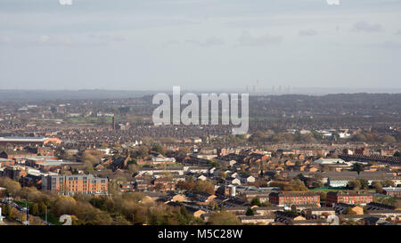 Liverpool, England, UK - November 9, 2017: Suburban housing sprawls across Liverpool, with Cheshire and Fiddlers - Stock Photo