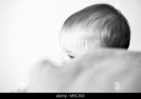 Cute baby girl toddler portrait playing hide and seek - Stock Photo