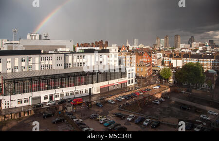 London, England, UK - July 24, 2009: Sunshine creates a rainbow over Mount Pleasant Sorting Office, with the skyline - Stock Photo