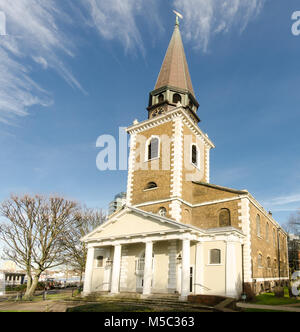 London, England, UK - January 14, 2014: Sun shines on the west front and spire of St Mary's Church, Battersea, on - Stock Photo