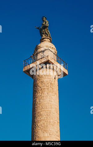 Trajan's Column (Colonna Traiana) in Rome, Italy. Commemorates Roman emperor Trajan's victory in the Dacian Wars - Stock Photo