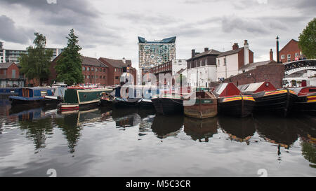 Birmingham, England, UK - June 23, 2012: Traditional narrowboats and barges are moored at Regency Wharf on the Birmingham - Stock Photo
