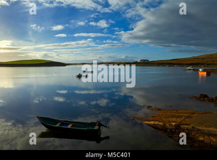 Curragh and rowing boats in  Achill Sound, Achill Island, County Mayo, Ireland - Stock Photo