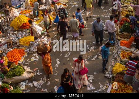 Flower selling market near Mullikghat of Howrah Bridge,Kolkata,West Bengal,India where flowers are selling at wholesale - Stock Photo