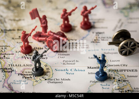 Macro close up of toy soldiers on a map representing conflict and tensions in the South China Sea - Stock Photo