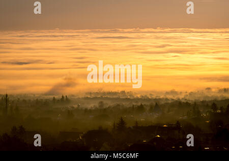 Sea of clouds in Navacerrada on a cold winter morning.Madrid sunrise. - Stock Photo
