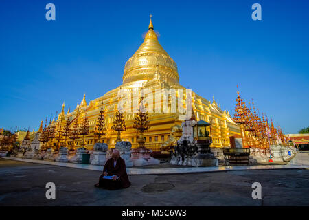 One of the largest pagodas in Bagan, the golden Shwezigon Pagoda in Nyaung U - Stock Photo