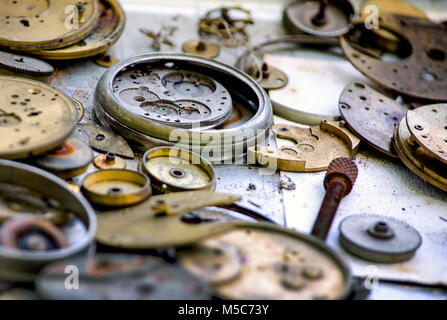 antique watch parts with tiny gears and bits - Stock Photo