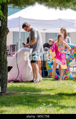 aug 5, 2017 Michigan USA; people stand in line to fill inflatable toys with air at the Thrill on the Hill event - Stock Photo