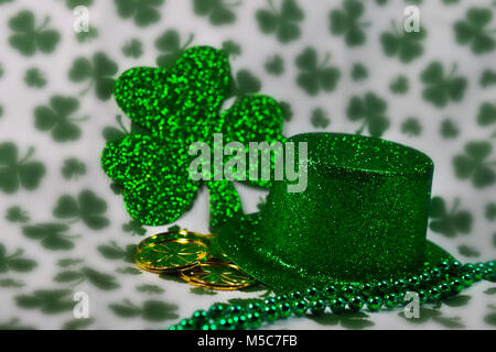 Irish Glittery Green Top Hat with Shiny Green Four Leaf Clover shamrock background and gold coins - #2 - Stock Photo