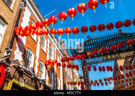 Colourful lanterns against a blue sky, adorning Gerrard Street in Chinatown to celebrate Chinese New Year. Westminster, - Stock Photo