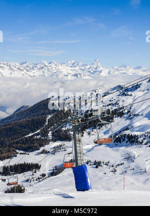 Panoramic view of wide and groomed ski piste in resort of Pila in Valle d'Aosta, Italy during winter. View Towards - Stock Photo