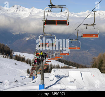 Pila, Aosta, Italy - Feb 19, 2018: Aerial view of northern Italian city of Aosta and surrounding Valle d'Aosta from - Stock Photo