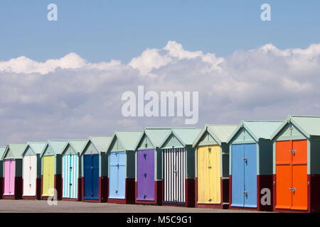 A row of colourful beach huts on Hove seafront near Brighton - Stock Photo