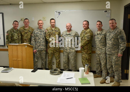 Members of the Missouri Army National Guard's Detachment 2, Company C of the 2-245th Aviation Regiment gather in - Stock Photo
