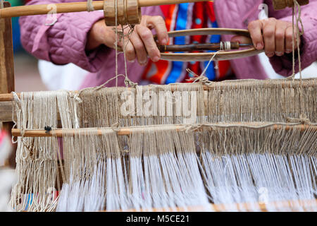 Belarus, the city of Gomel, June 3, 2017. Independence Day in Belarus.Grandmother works behind an old spinning machine.Spice - Stock Photo