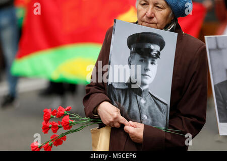 Belarus, Gomel, May 9, 2017, the Victory Day celebration.A woman carries a photograph of a father's soldier who - Stock Photo