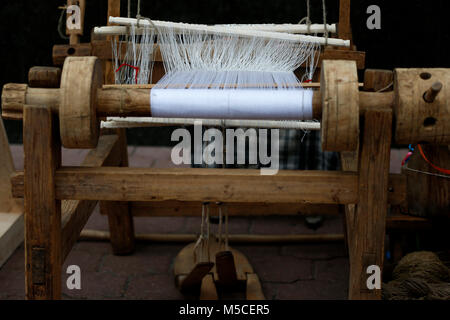 Belarus, Gomel, May 9, 2017, the Victory Day celebration,Ancient spinning machine.An ancient way to fabricate.Loom - Stock Photo