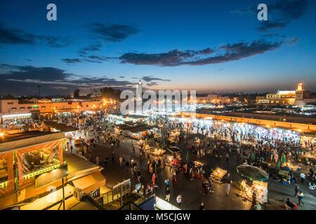Famous Moroccan market square Jamaa el Fna in Marrakesh medina quarter, called also Jemaa el-Fnaa, Djema el-Fna - Stock Photo