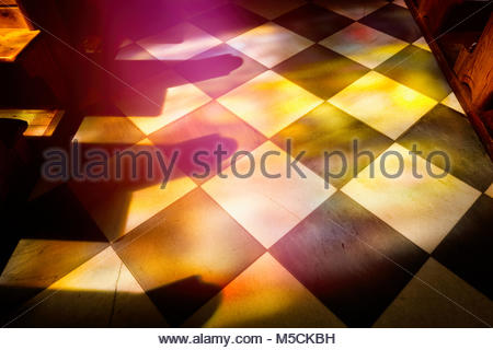 Church pew chapel stained glass window reflection - Stock Photo