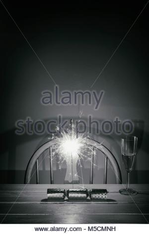 Christmas cracker Celebration sparkler wine glass - Stock Photo