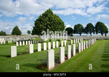 Rows of gravestones at Cabaret Rouge British War Cemetery - Stock Photo
