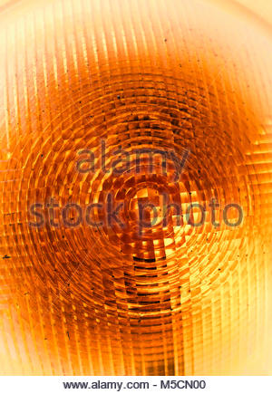 Orange traffic warning light yellow close-up - Stock Photo