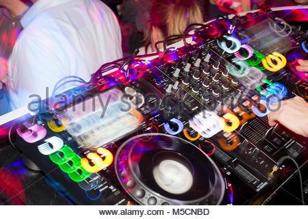 DJ disco nightclub mixing desk turntable equipment - Stock Photo