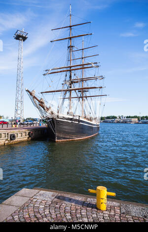Vintage brig stands moored in Helsinki port, old wooden sailing ship - Stock Photo