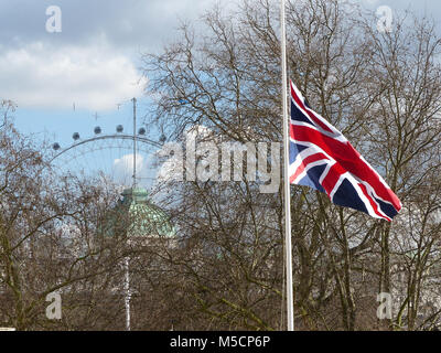 Union flag at half mast with London Eye in background - Stock Photo