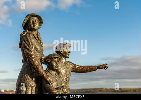 Statue of Annie Moore in Cobh, County Cork, Ireland, with her brothers, first Irish immigrant to the United States in 1892 with copy space.