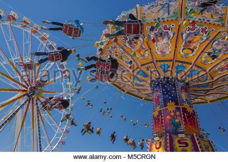 People tourists chain swing carousel Oktoberfest - Stock Photo