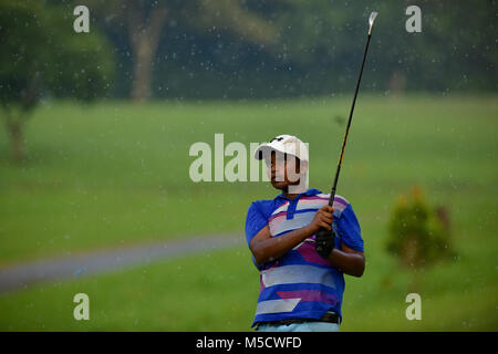 Danau, UKM Bangi - FEBRUARY 10: Dylan Alvin Augustine watches his tee shot on the 16th hole during Round One of - Stock Photo