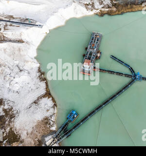Aerial photograph of a large suction dredger in a wet mining process for quartzite snow-white sand, made with drone - Stock Photo