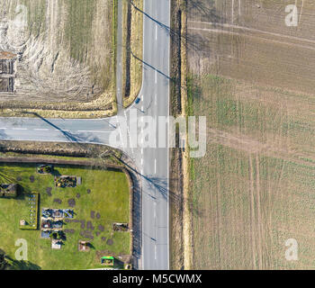 Aerial view of the turn off to the left of a country road in Germany. Abstract impression due to vertical angle - Stock Photo