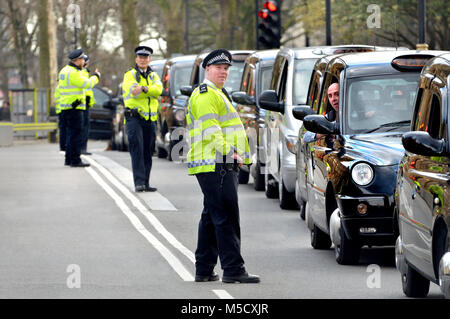London, England, UK. Police and taxi drivers during a protest against the Uber taxi app - Stock Photo