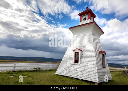 Anderson Hollow lighthouse by the Shepody River dam in Harvey, Bay of Fundy, New Brunswick. Summer day with rolling - Stock Photo