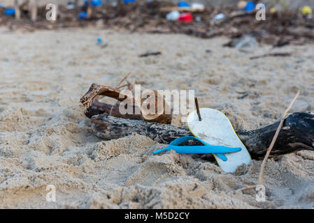Rubbish and domestic waste polluting the beach - Stock Photo