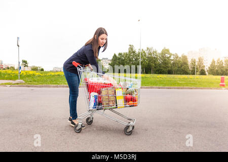 Young woman made all necessary purchases for home - Stock Photo