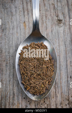 Close up of dry caraway seeds. with Spoon full