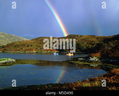 Rainbow over Loch Glencoul, near Kylesku on the west coast of Sutherland, Highland, Scotland - Stock Photo