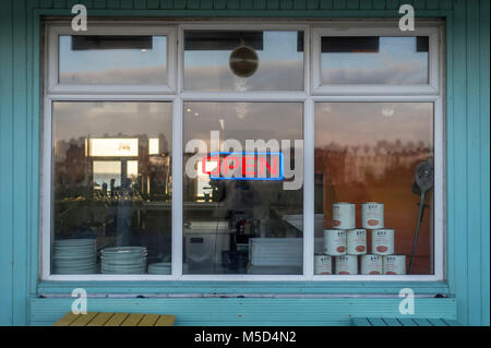 neon open sign in the window of a cafe, restaurant. - Stock Photo