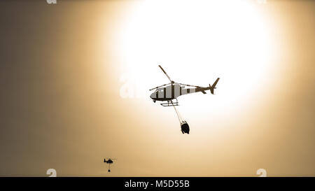 firefighter helicopter fighting in a hot day - Stock Photo