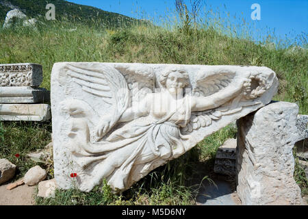 Historic relief sculpture of Nike, goddess of victory, Ephesus, Turkey -  Stock Photo