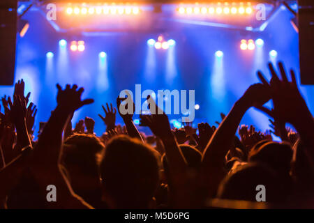 Fans in the audience cheering during the concert of the German-Lebanese rapper MoTrip live at the Schüür, Lucerne, - Stock Photo